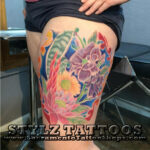 flowers on leg tattoo water color
