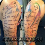 big script writing tattoo on arm